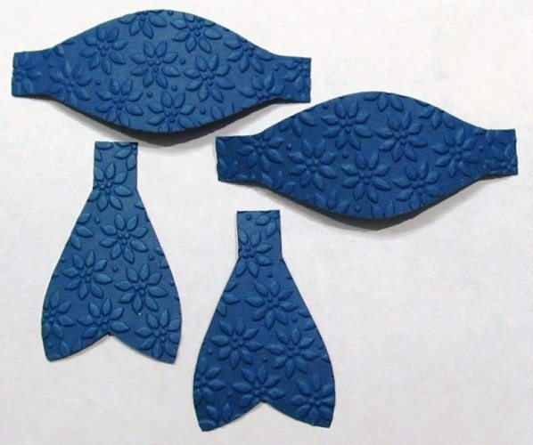 embossed cut bow pieces
